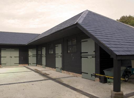Goodwood Stables with cat slide roof