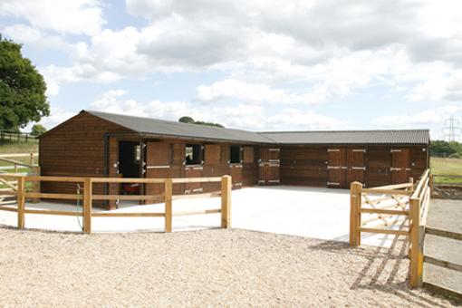 Hunter Stables with black Onduline roof