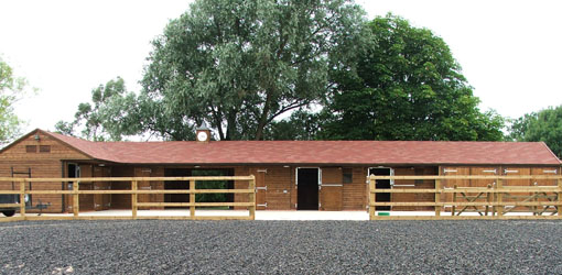 Stable block behind a large menage
